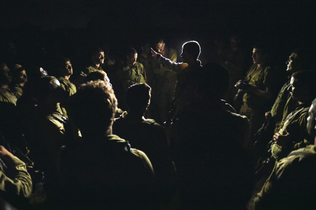Infantry commander briefs his troops before entering Gaza.